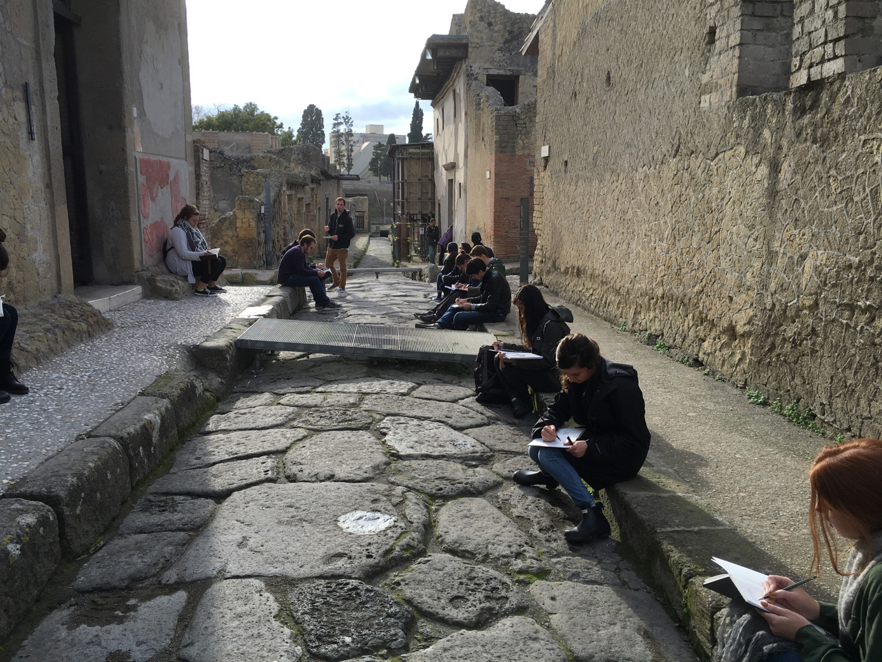 Iowa State students sketching at the ruins of Herculaneum in Italy.