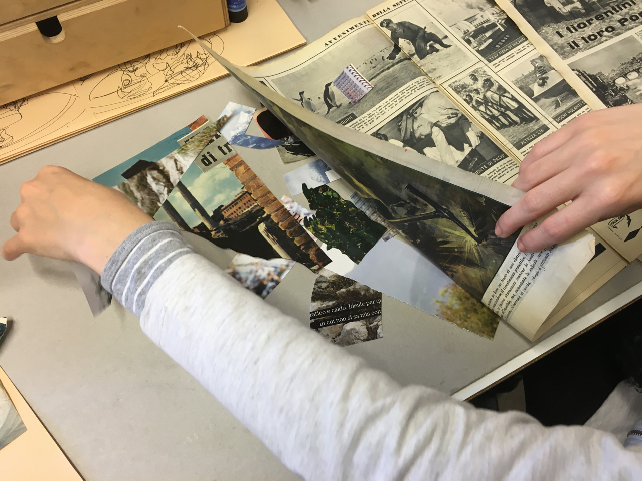 A student creates a collage during a workshop by Italian architect and artist Luca Garafalo, who is known worldwide for his architectural collages.
