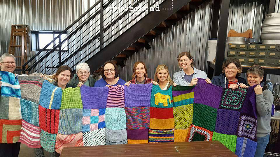 "Volunteers turned out at ""block parties"" over several weekends to help sew the squares into larger blankets, which will be attached to wooden stretchers."