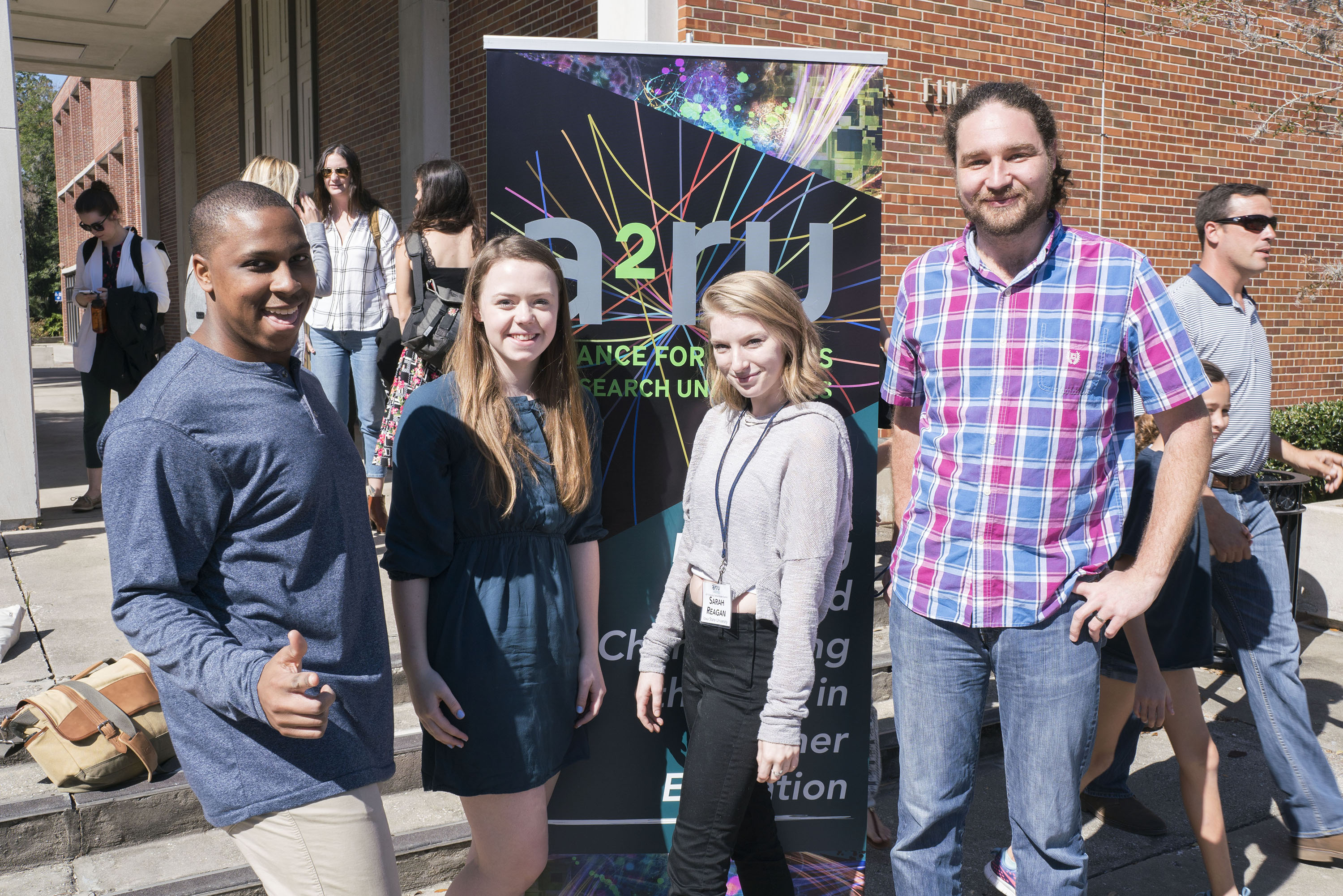 College of Design students Matt Wilson, Lauren Roberts and Sarah Reagan with art and visual culture Assistant Professor Austin Stewart at the a2ru Emerging Creatives Student Summit in Gainesville, Florida