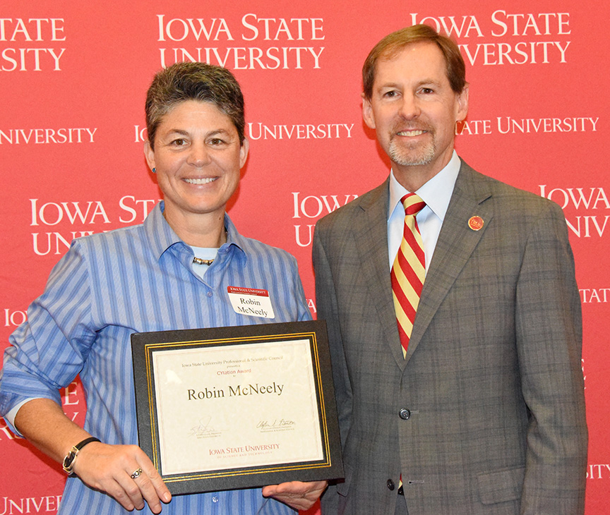 P&S CYtation Award recipient Robin McNeely, manager of the ISU GIS Support and Research Facility, with Jonathan Wickert, ISU senior vice president and provost.
