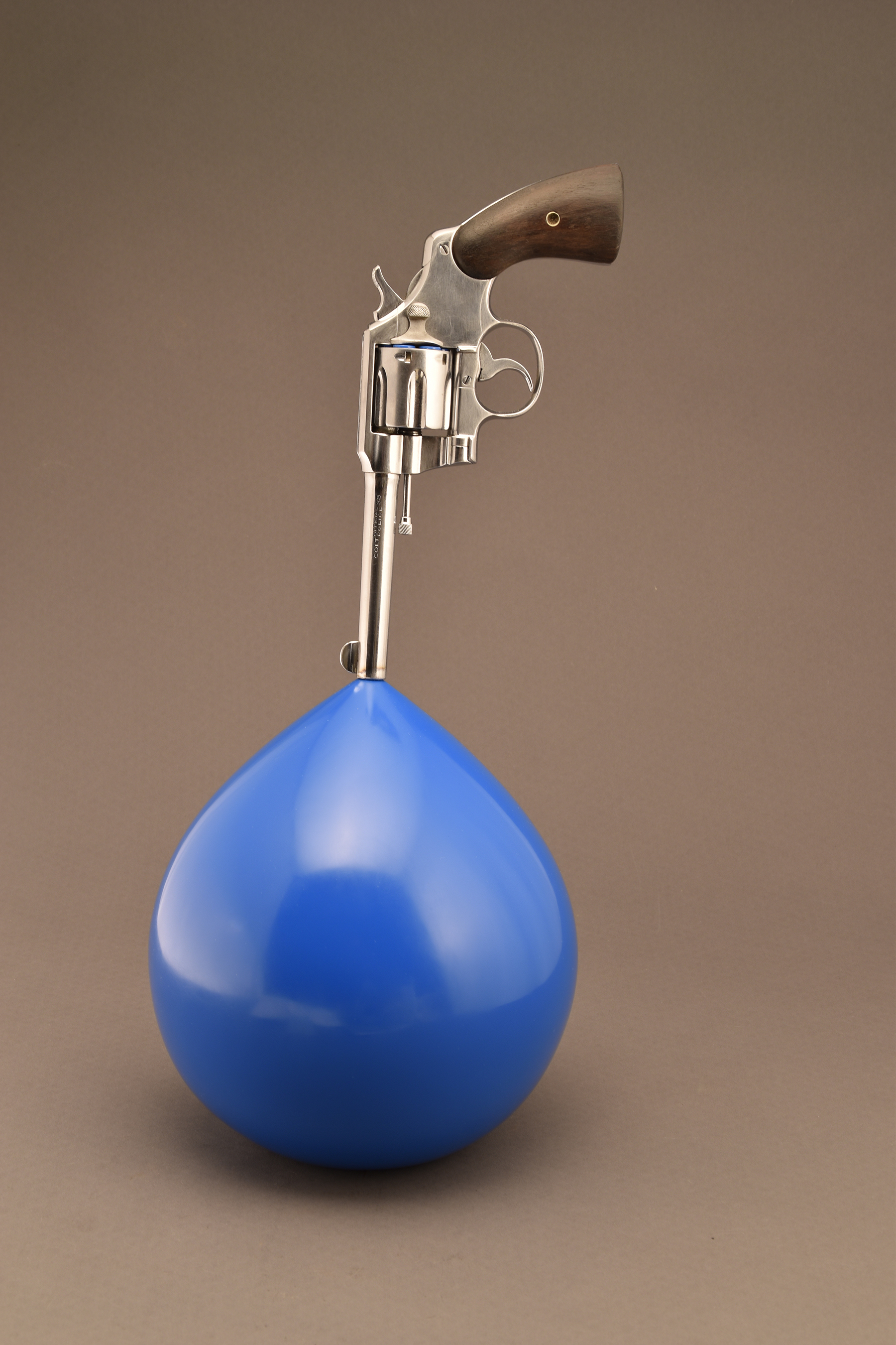 """Bubble Gun"" (handgun, steel, wood, chrome, enamel paint, plastic), hand-formed and fabricated using traditional metalsmithing and automotive/aircraft metal-shaping techniques, by Joe Muench"