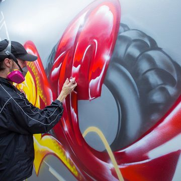 New integrated studio arts alum creates wall mural