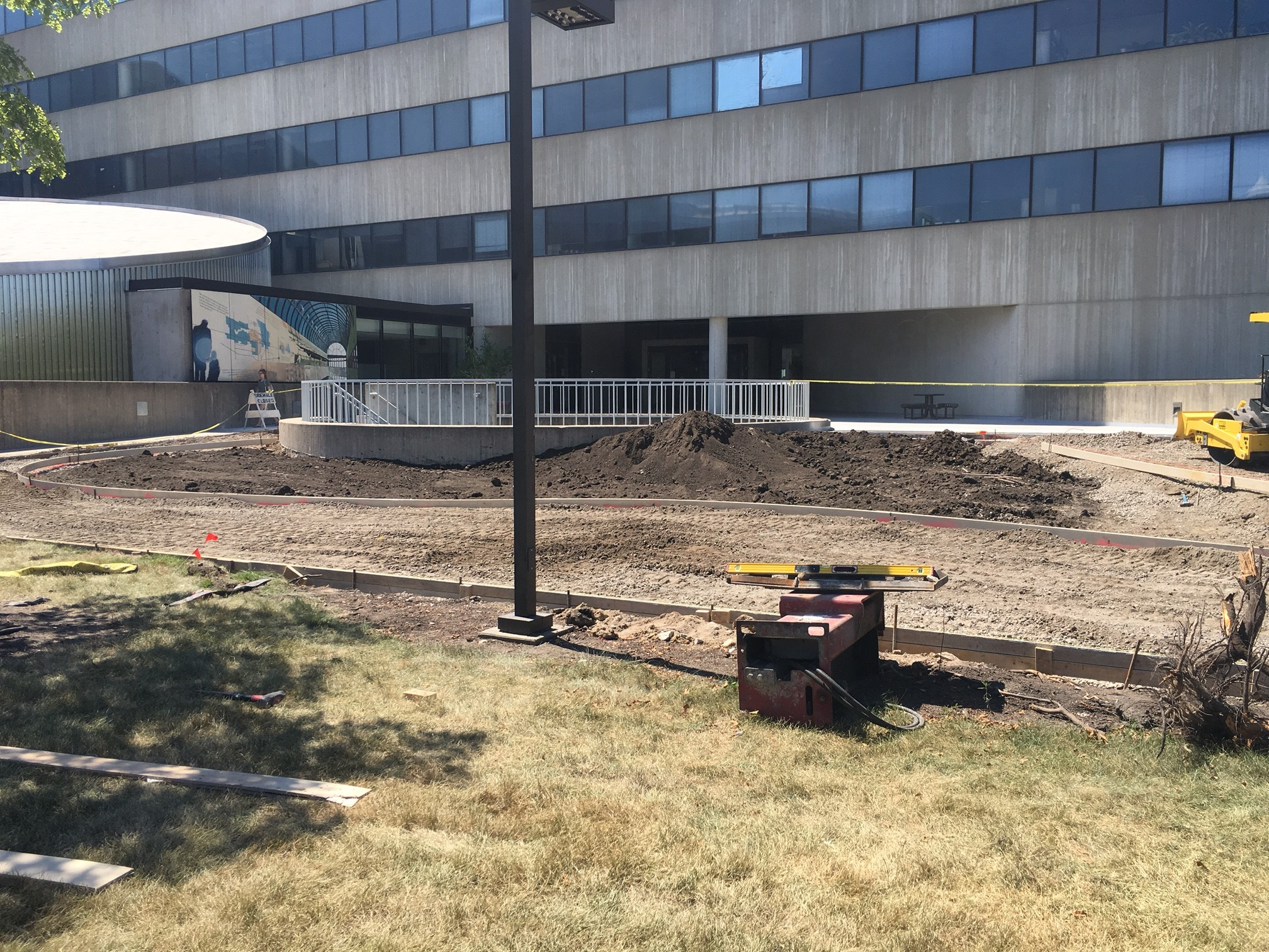 Three mature crabapple trees were removed from the south side of the entrance plaza. These were replaced elsewhere with aspens.