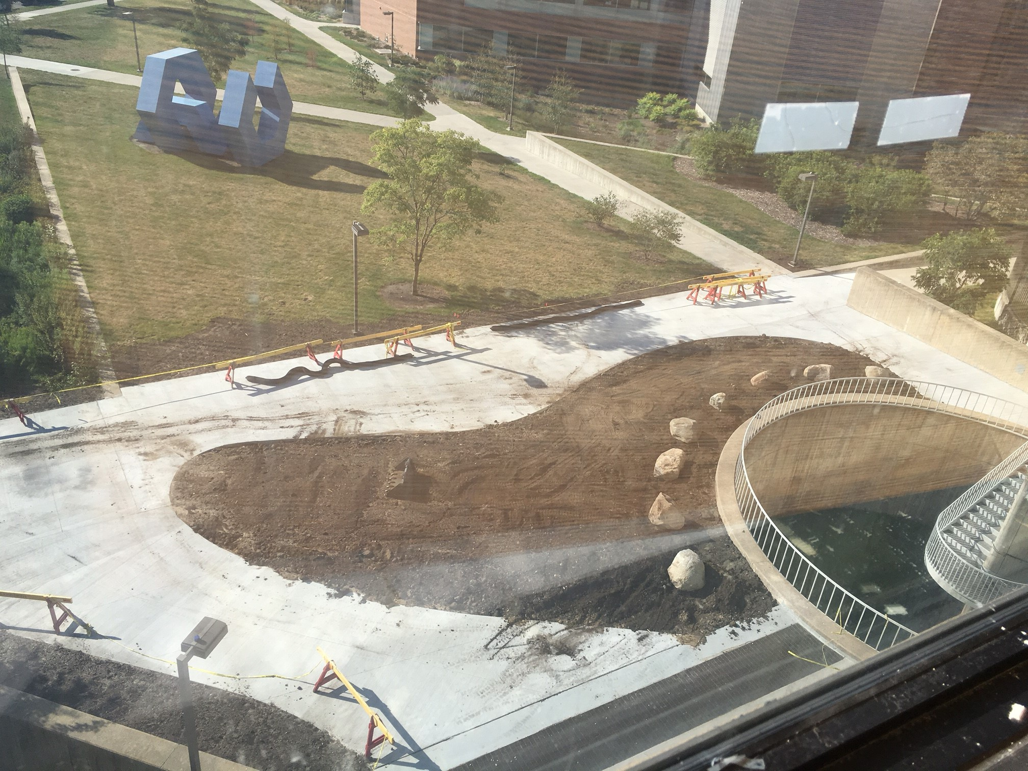 A view from above shows the new earthen mound and significantly reduced amount of pavement at the front entrance to the College of Design.