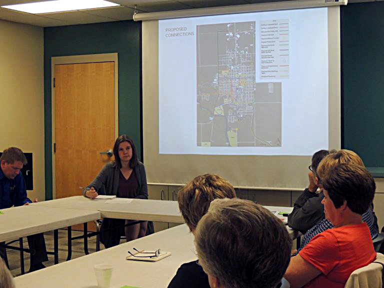 Zoey Mauck leads a public meeting to solicit feedback on her proposed trail routes through the community.