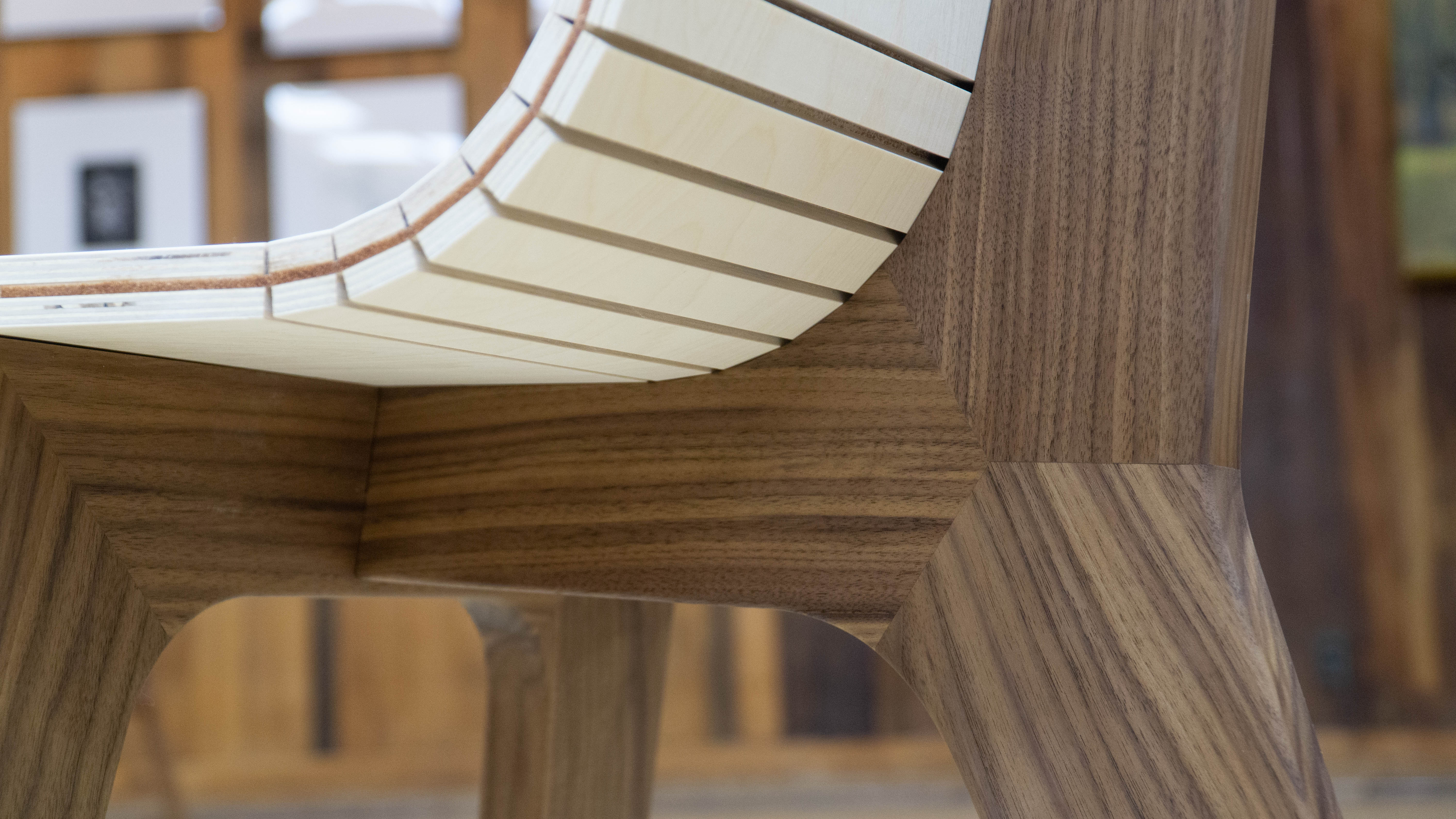 "Detail of the ""72.5 Chair"" by Samuel Christianson and Nathan Miklo showing leather and kerfed plywood seat construction and leg assembly."