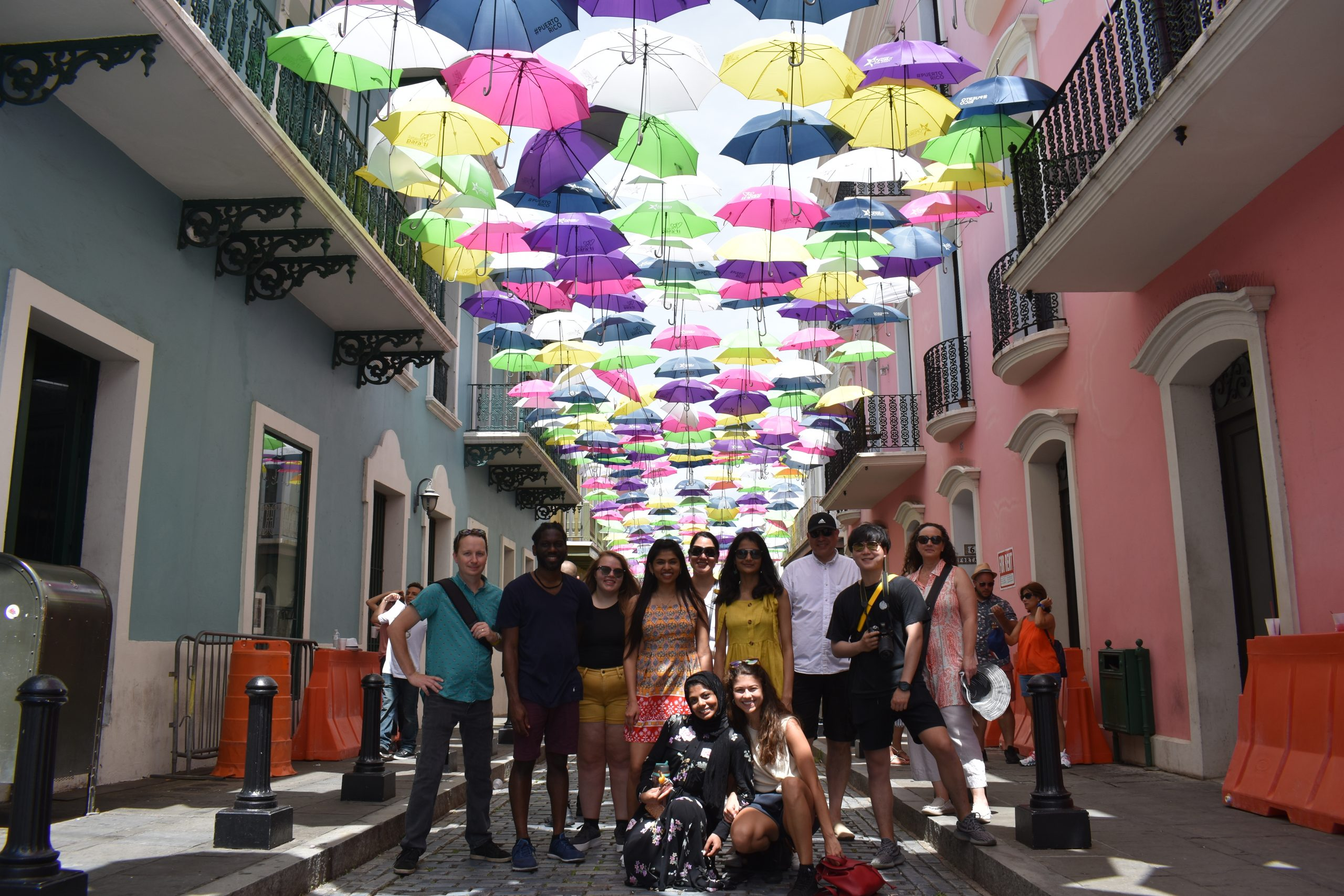 Iowa State University urban design studio students and faculty visit the colorful umbrella installation on Fortaleza Street in Old San Juan, Puerto Rico