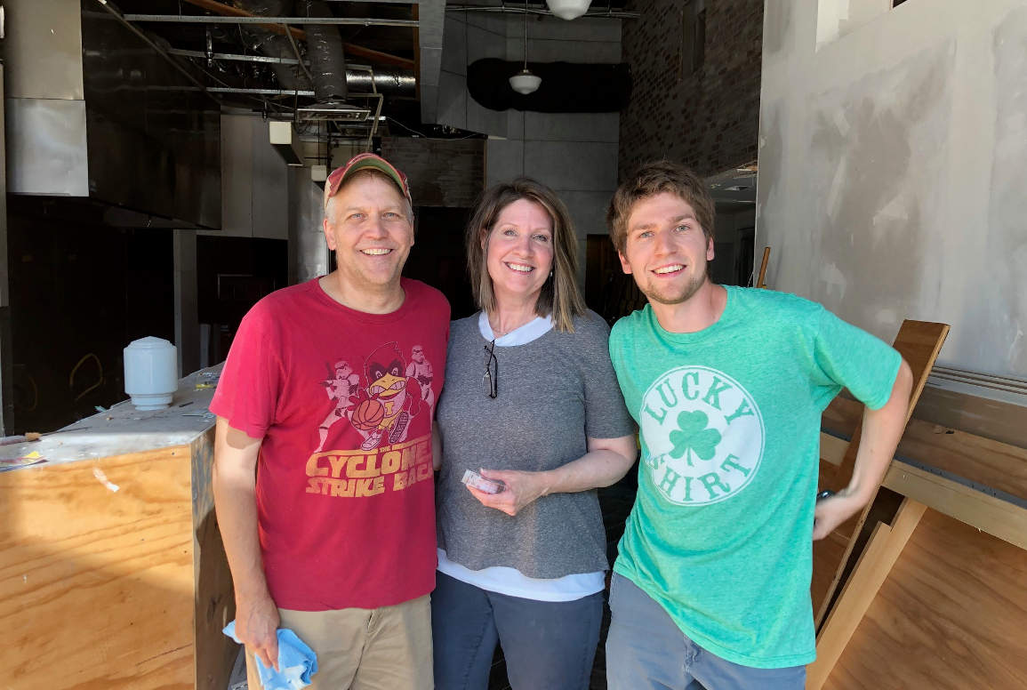 Kevin, Susan and Alex Felker are co-owners of the Prairie Kitchen Store under construction in downtown Iowa City. Photo by Matt Steele/Little Village