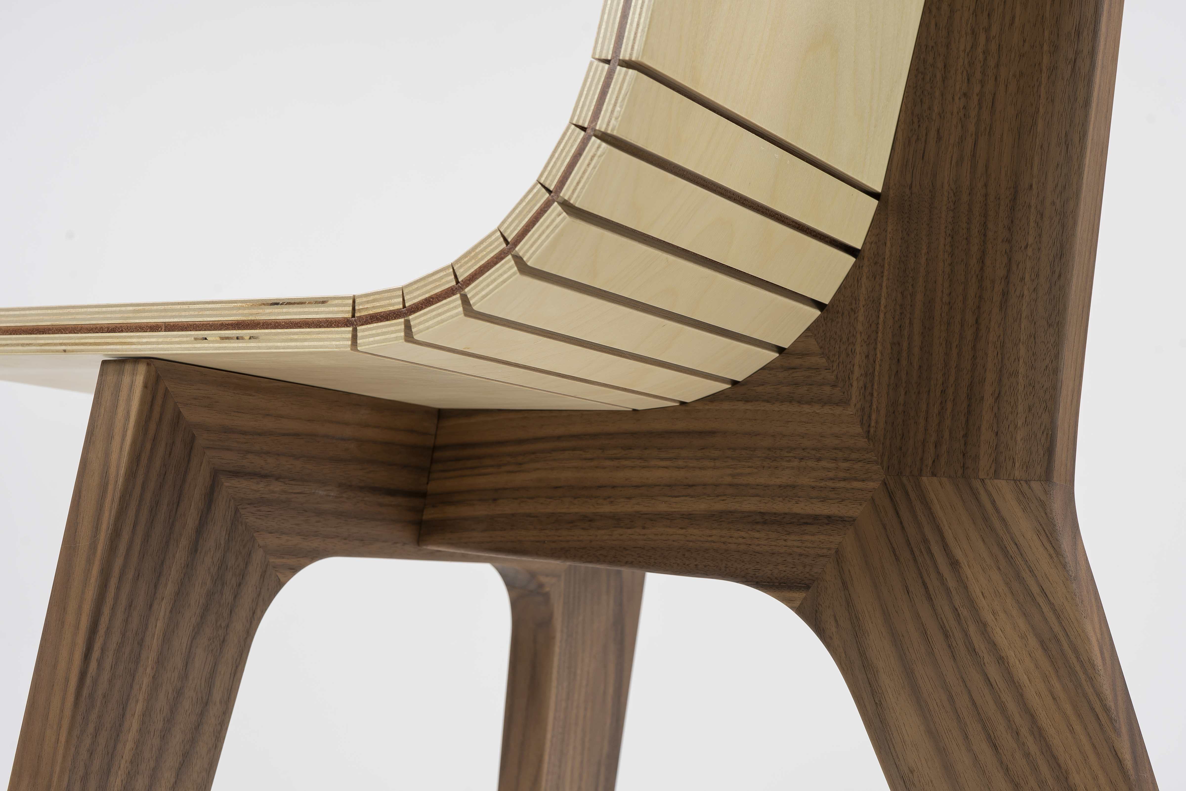 "Detail image of Sam Christianson and Nathan Miklo's ""72.5 Chair"" showing the joinery and kerfed birch blywood seat"