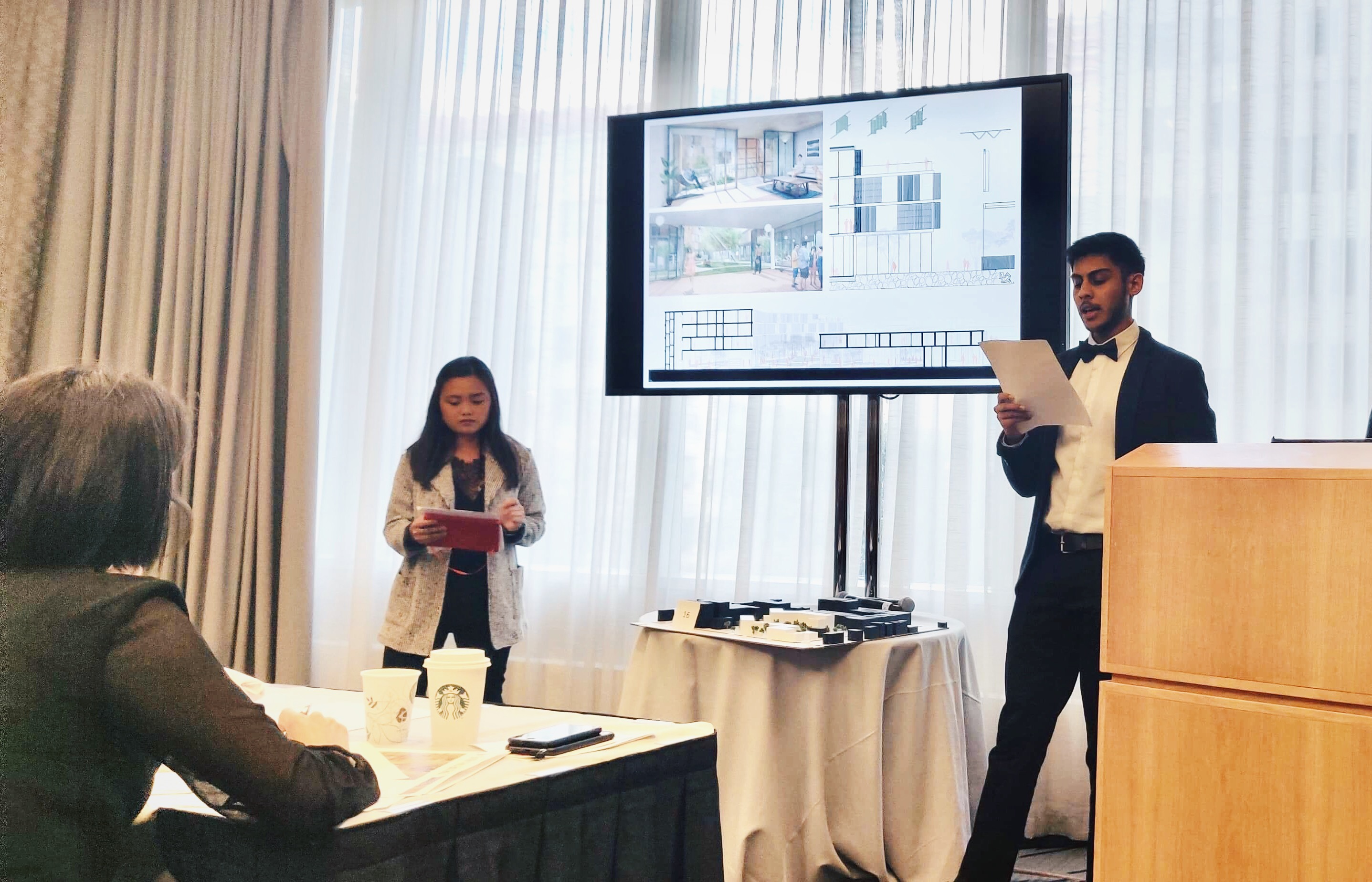 Iowa State architecture students Alyanna Subayno and Obbishek Mandal present their team's project in the Barbara G. Laurie Student Design Competition at the NOMA'19 Conference in New York City