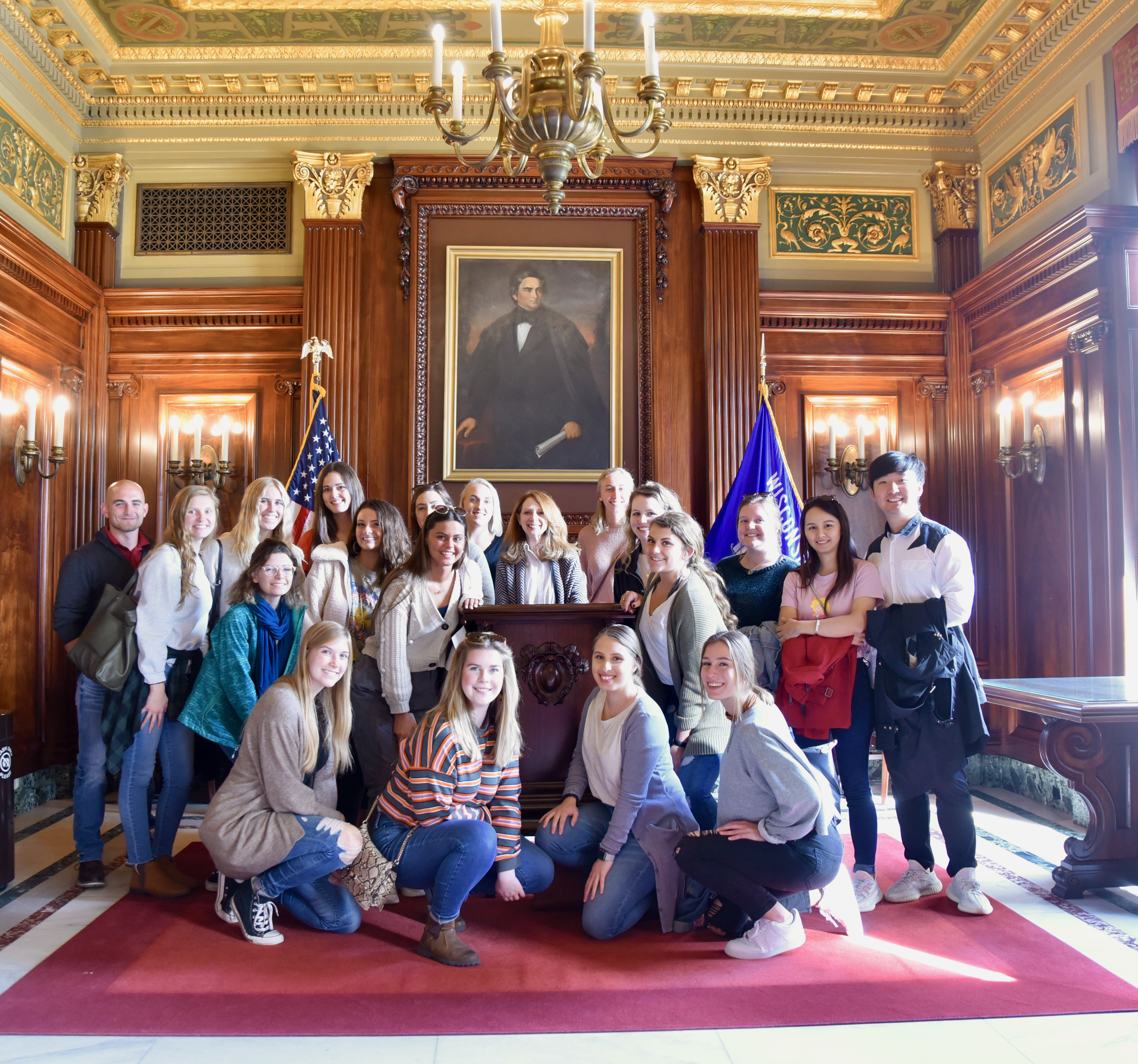 ARTID 569D: Preservation students with Diane Al Shihabi, associate professor of interior design, standing behind the lectern she designed for the Senate Parlor during the Wisconsin State Capitol restoration