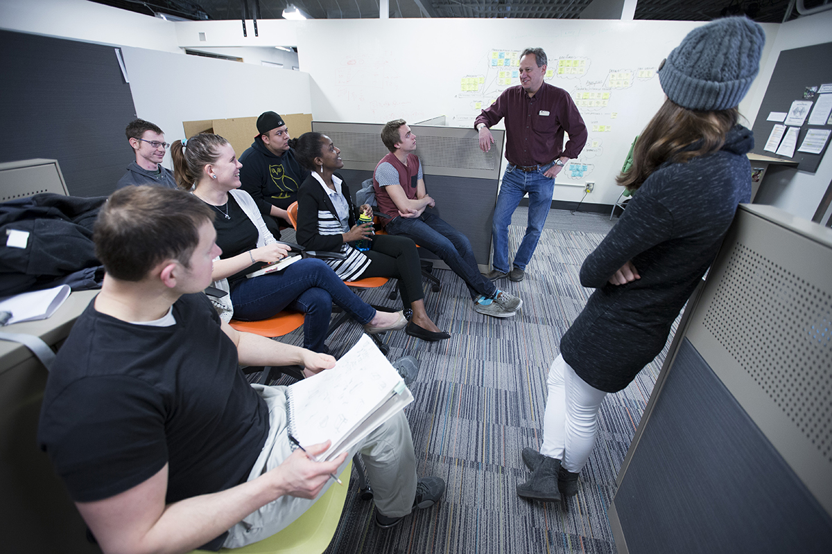 Industrial design graduate students with professor Steve Herrnstadt in the Armory. (photo by Christopher Gannon/Iowa State University)