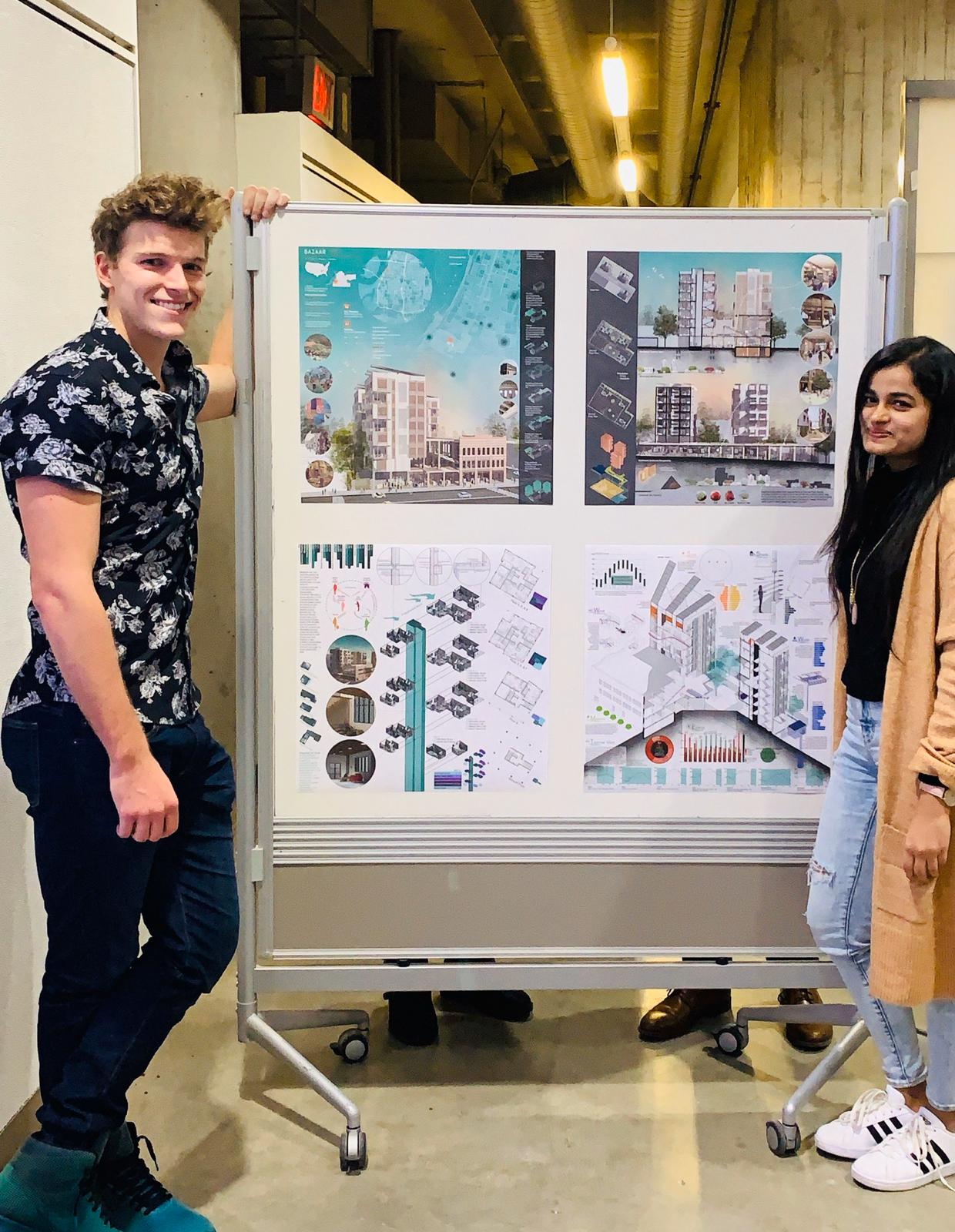 "ISU second-year architecture graduate students Connor Mougin, left, and Anannya Das, right, with their award-winning ""Bazaar 324"" project boards."
